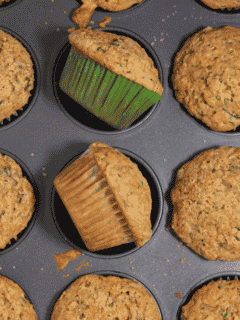 zucchini muffins laying in muffin tin