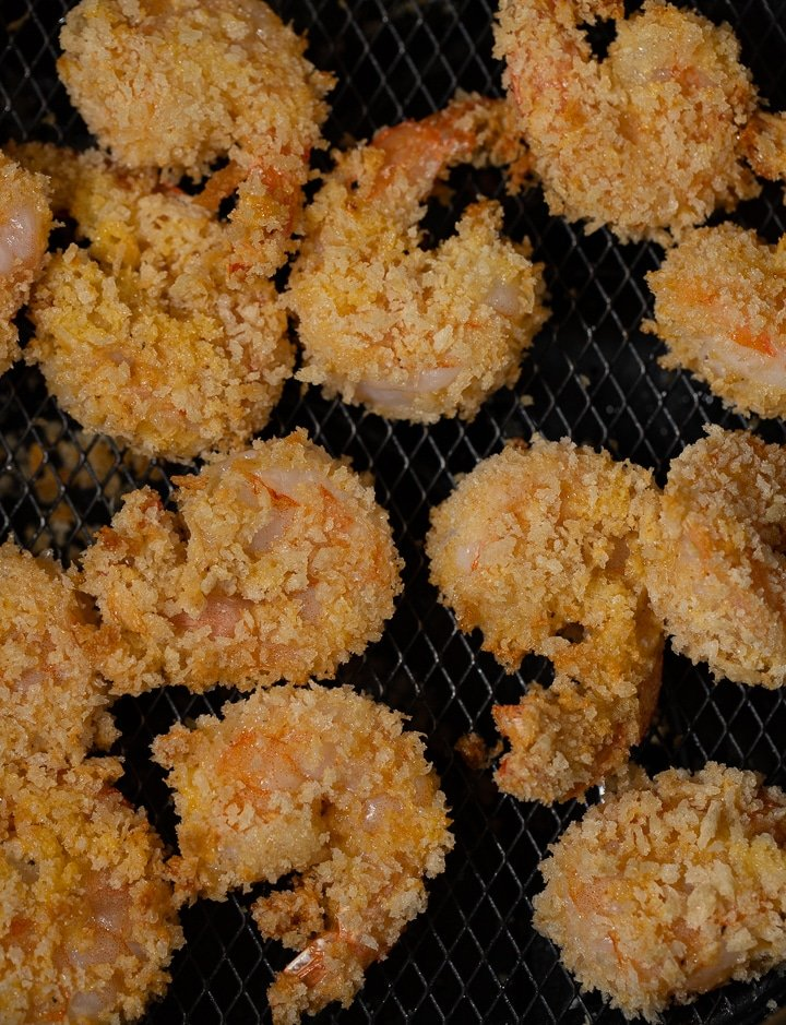 Close up of the shrimp in an air fryer basket