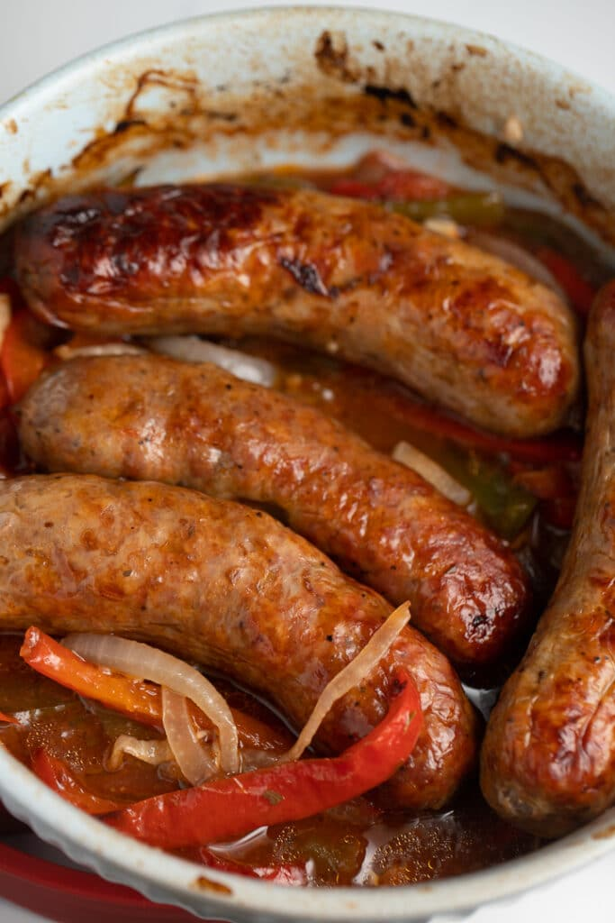 Air fried sausages on top of the cooked vegetables