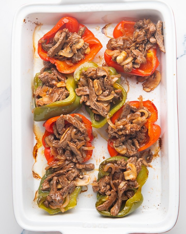 The cheesesteak filling in the pepper halves