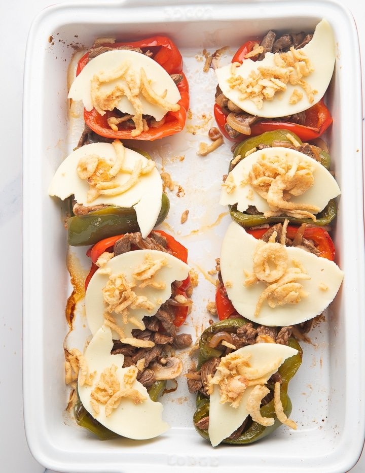 Cheese placed on top of the peppers