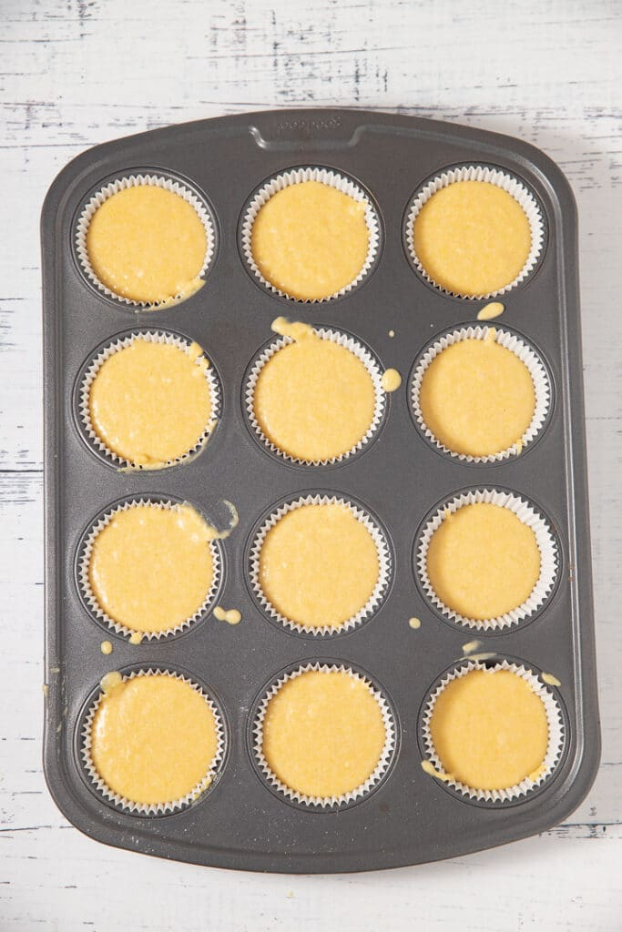 The cornbread muffin batter in a muffin tin