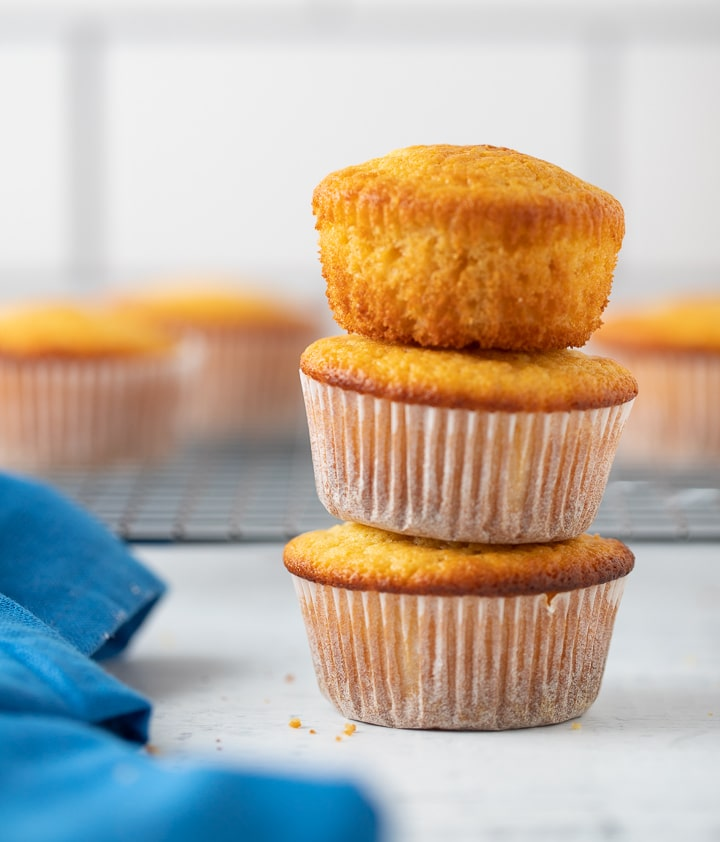 Three cornbread muffins stacked on top of eachother