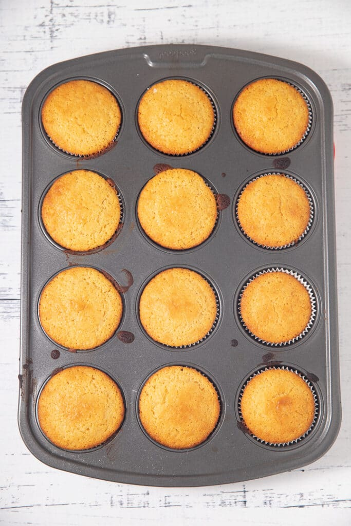 Baked cornbread muffins in a tin
