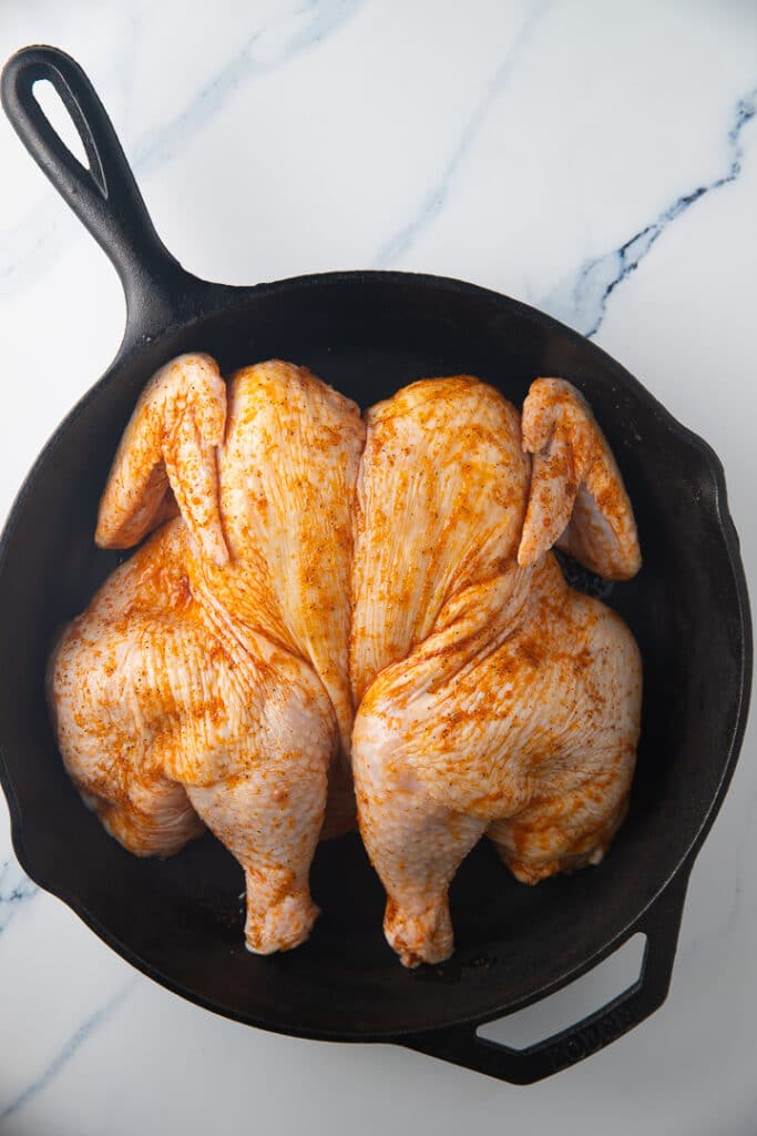 The chicken in a cast iron skillet