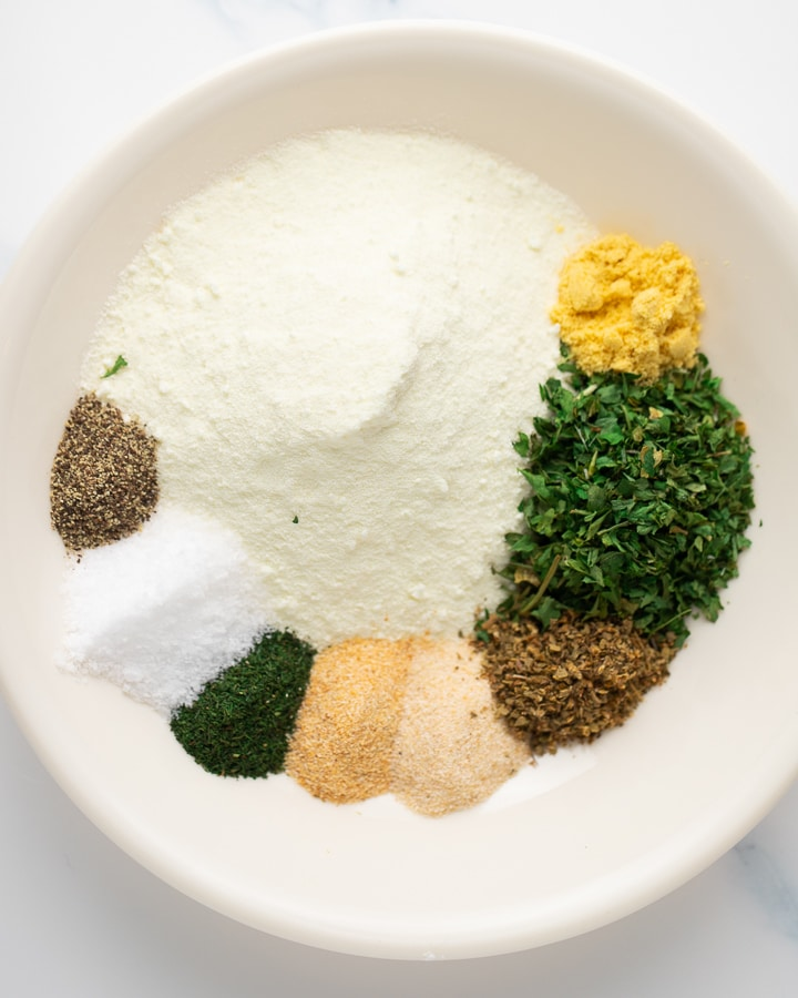 Herbs and spices in a white bowl