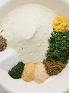 herbs and spices for ranch seasoning on a white plate