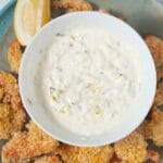 tartar sauce on plate surrounded by shrimp