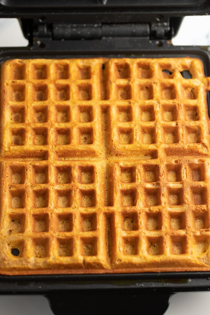 The cooked waffles in the waffle iron