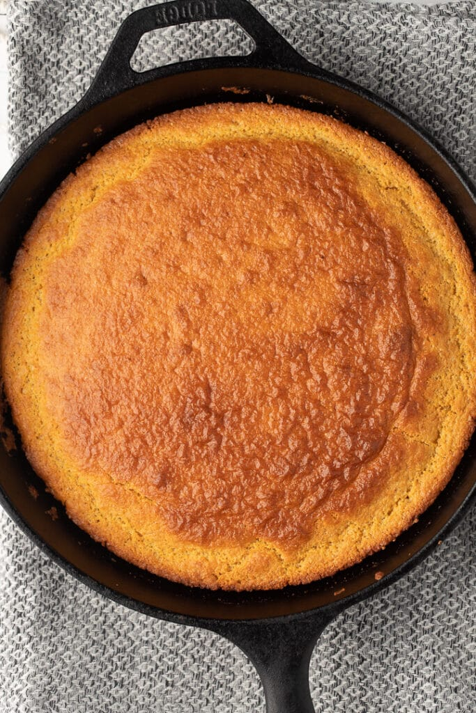 The baked cornbread in a skillet