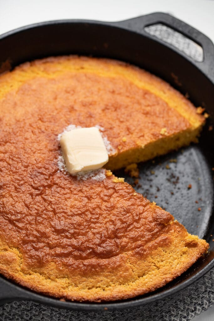 cornbread in skillet with butter on top