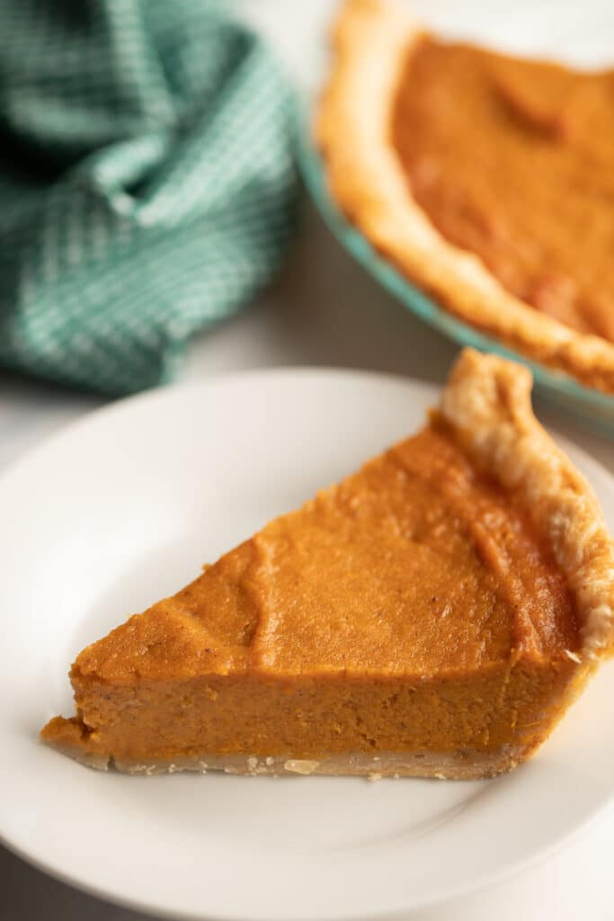 A slice of southern sweet potato pie served on a white plate