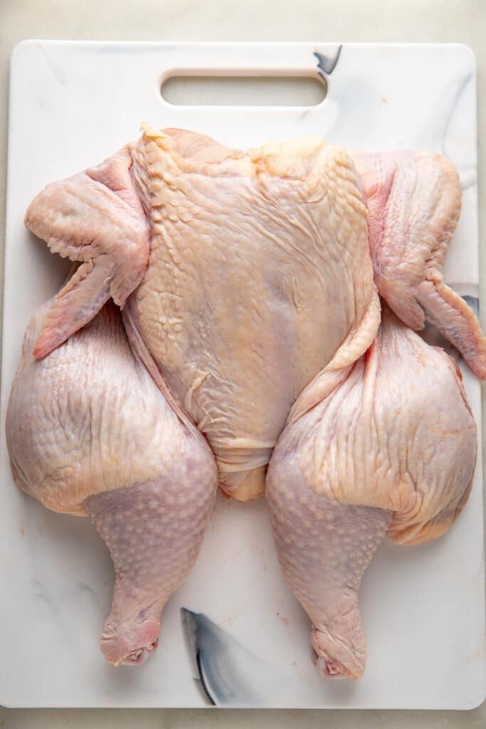 A flattened spatchcock chicken