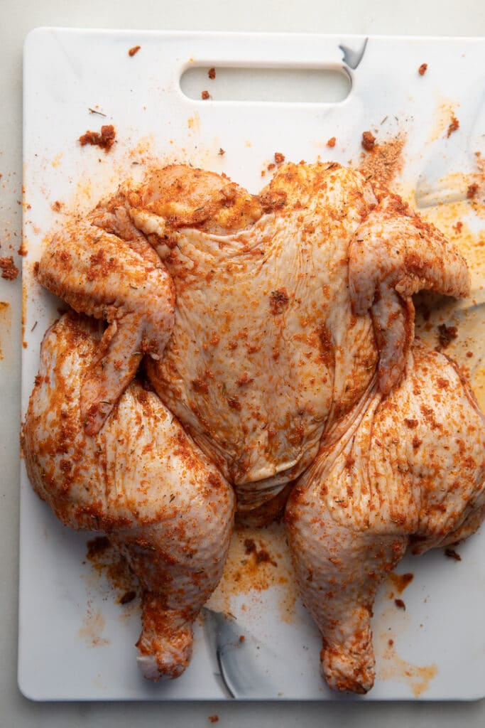 A spatchcock chicken rubbed with seasoning