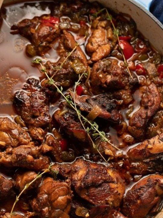 brown stew chicken in pan