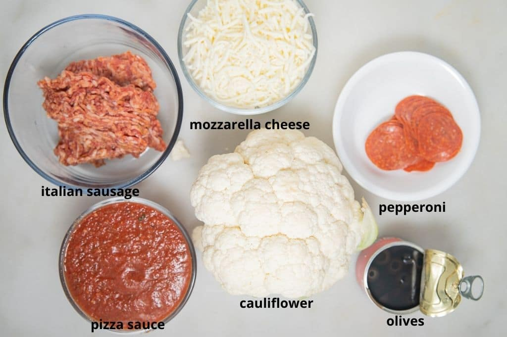 ingredients for cauuliflower pizza casserole on a white background with text of ingredients