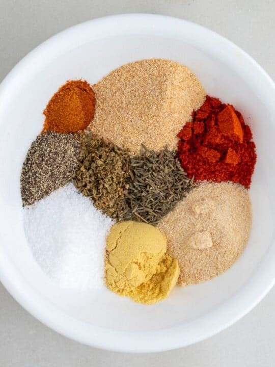 chicken spices in white bowl
