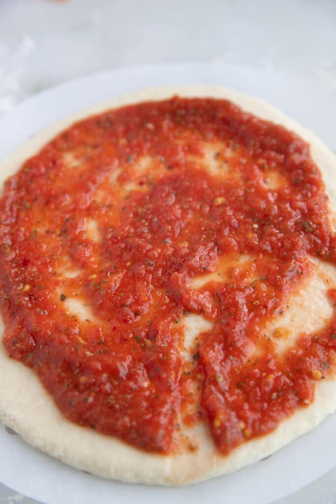 The sauce spread on pizza dough.
