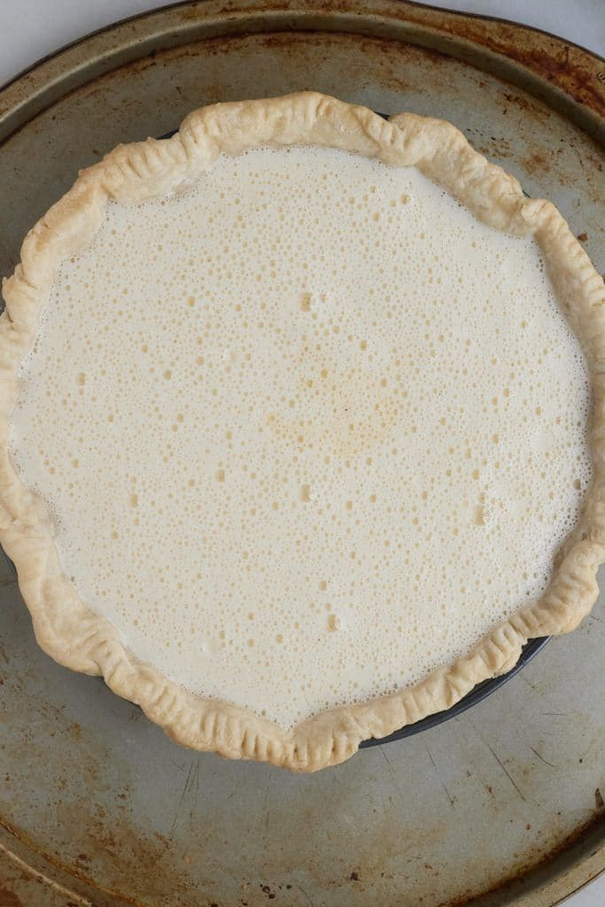 The filling poured into the part baked pie crust.