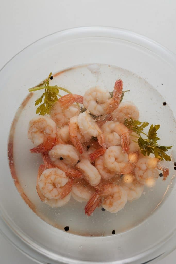 Cooked shrimp in a glass bowl.