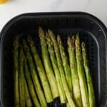 asparagus in an air fryer basket