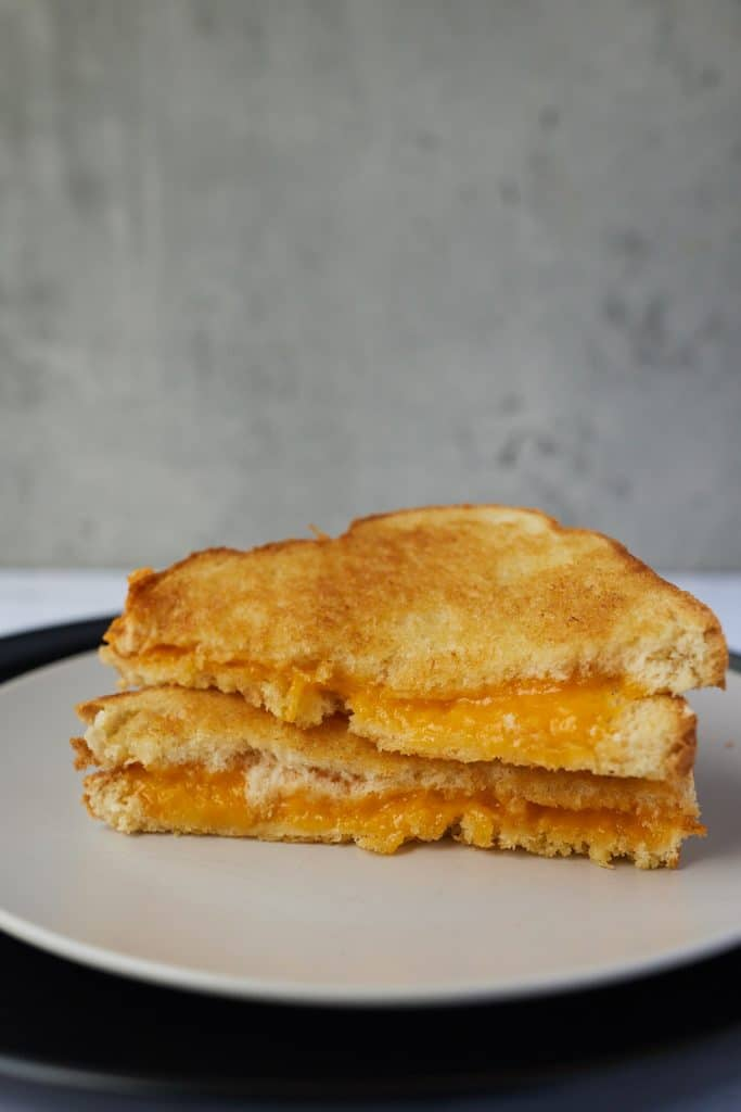 A grilled cheese cut in half.