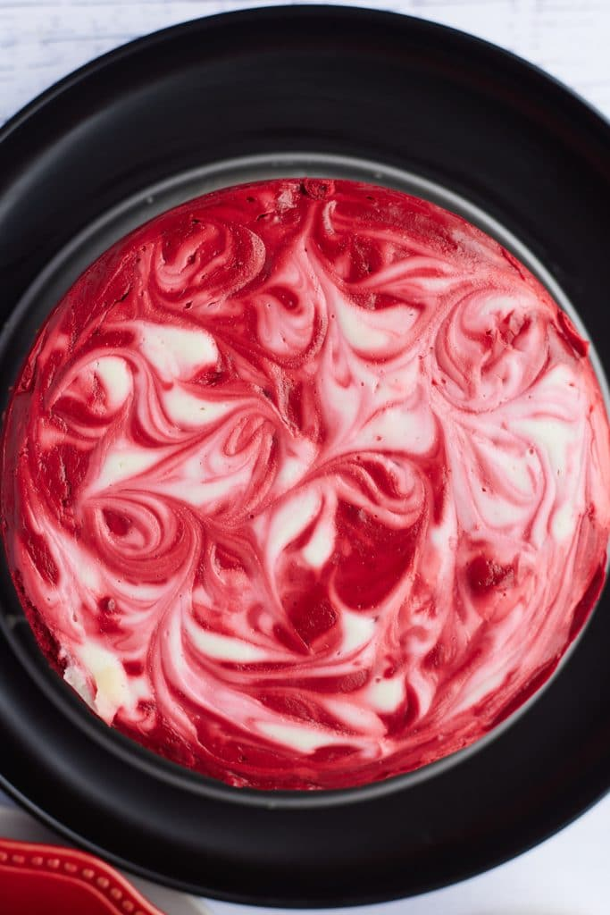Overhead view of the red and white cheesecake.