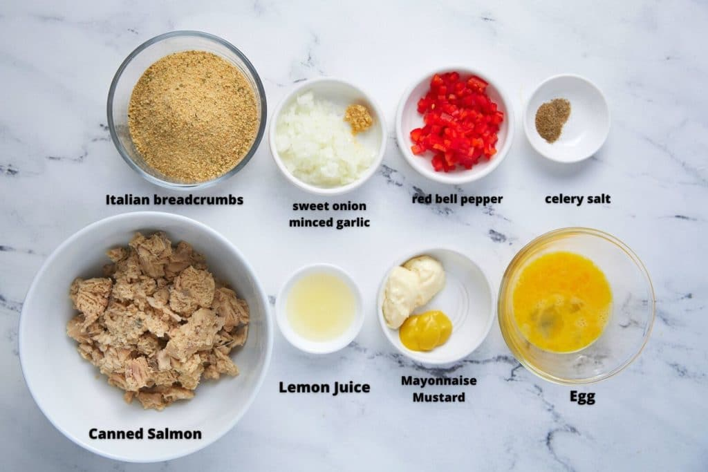 Ingredients to make the salmon patties in glass bowls.