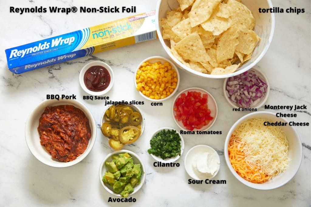 ingredients for bbq nachos on white background