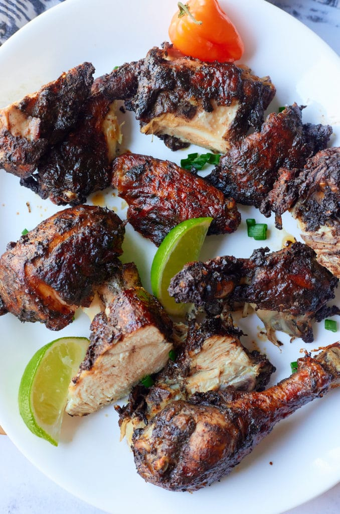 Jamaican jerk chicken cut up on a plate ready to eat.