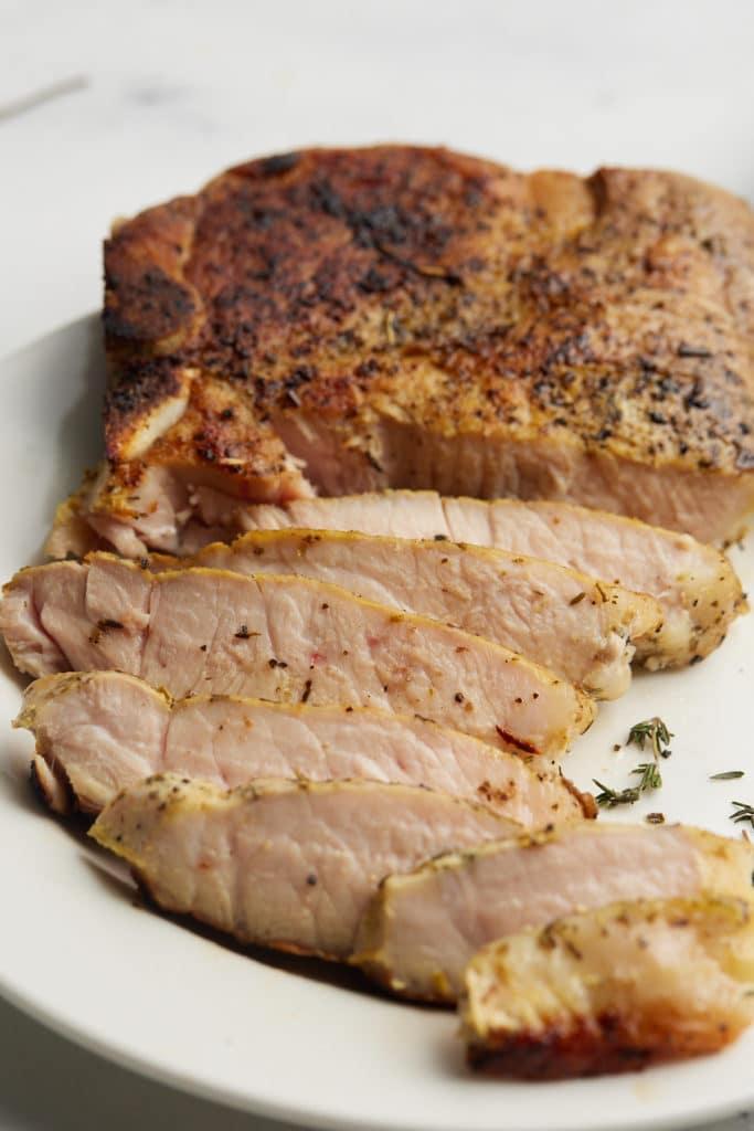 sliced pork chop on white plate