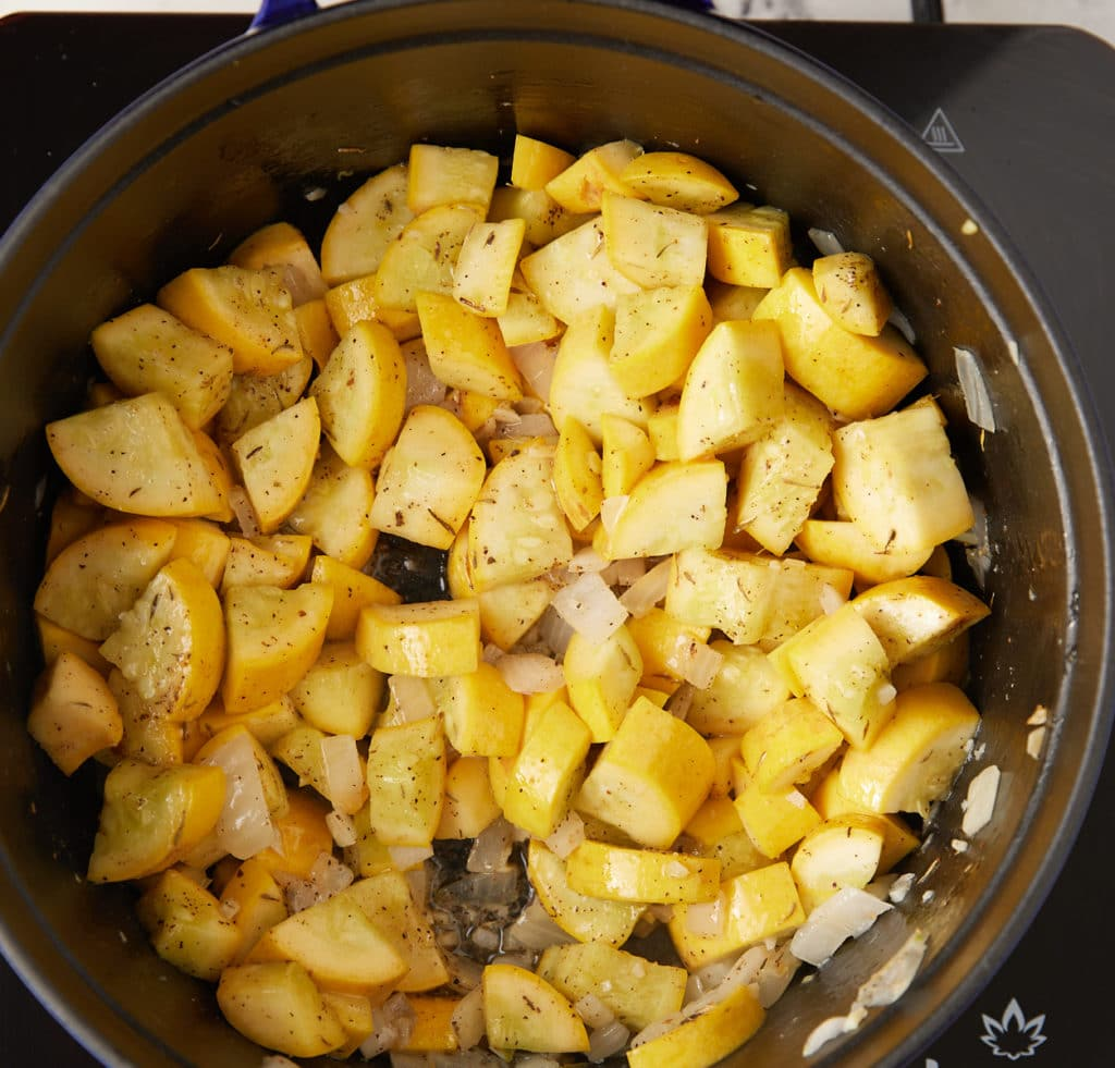 Cooking the squash and spices in a pan.