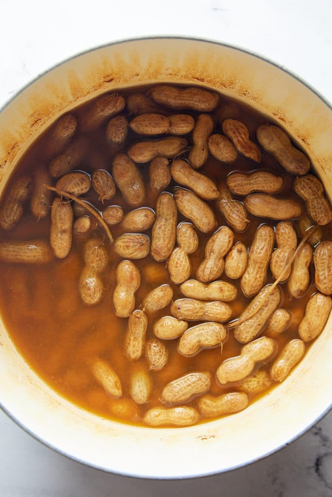 The cooked peanuts in a large pot.