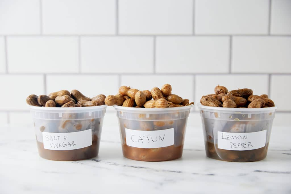 Flavored boiled peanuts in plastic cups.