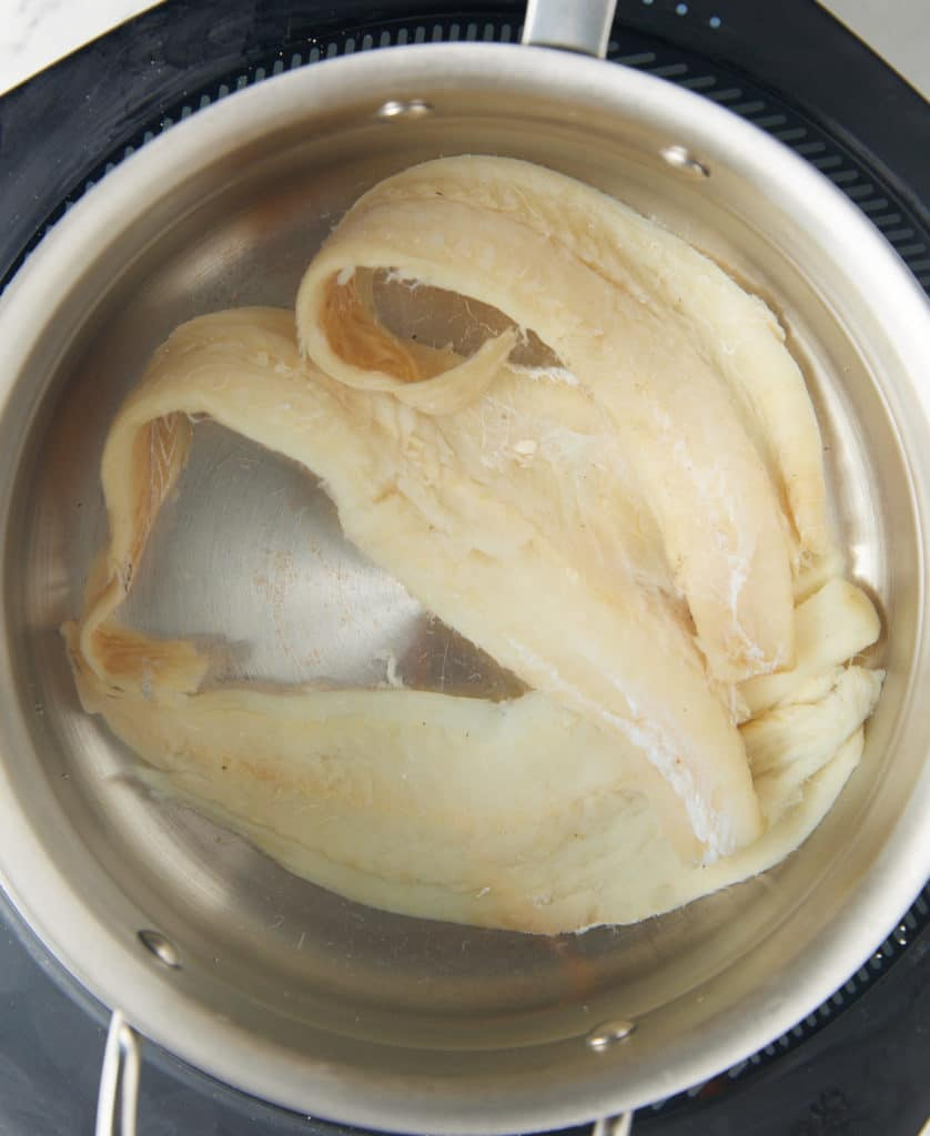salted codfish in pot of water