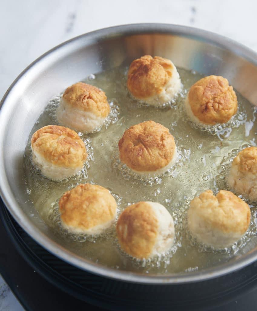 dumplings frying in oil