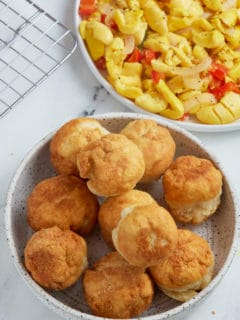 fried dumplings sitting in bowl with ackee in a bowl to the right