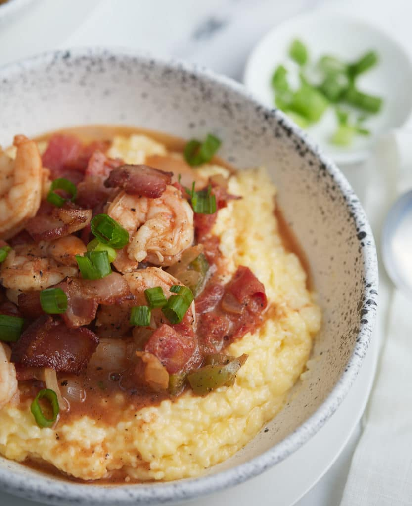 Close up of the shrimp and grits in a bowl ready to eat.
