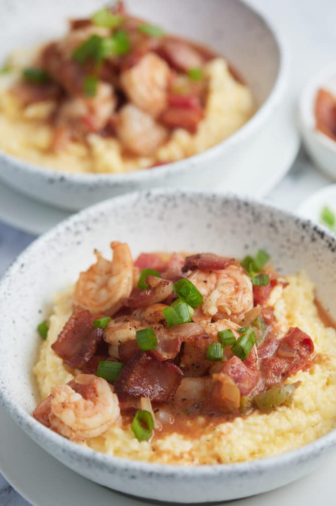 Tow bowls of Southern style shrimp and grits.