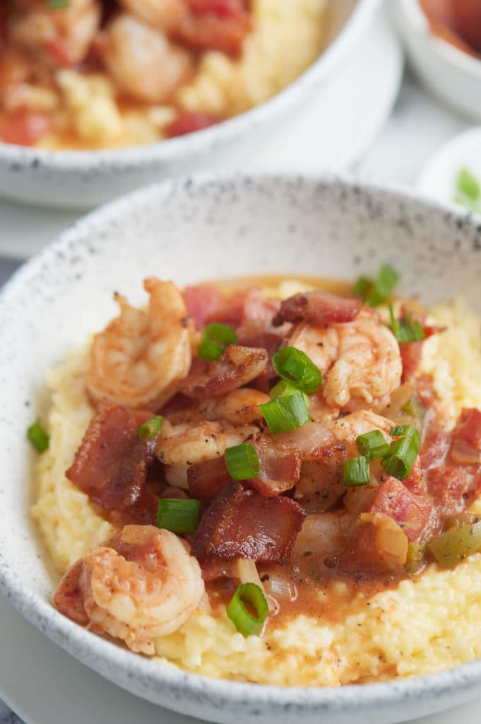 Close up of the cooked shrimp served on top of the cheesy grits.