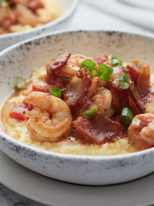 Southern style shrimp and grits served in a bowl.