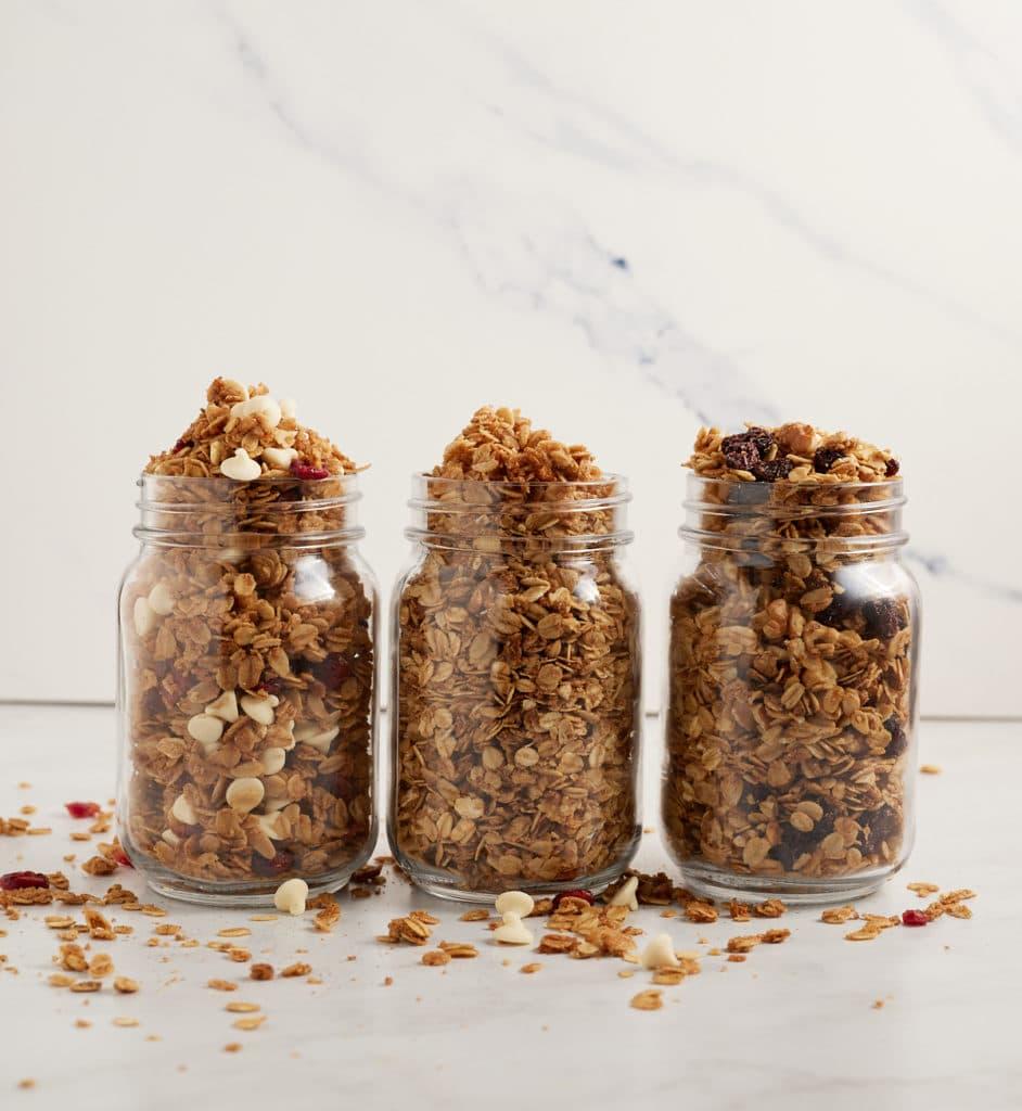 Three glass jars of air fryer granola.