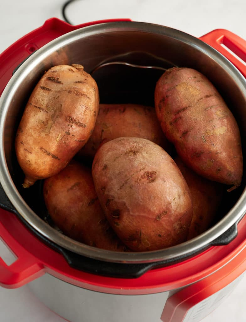 Sweet potatoes and water in an Instant Pot.