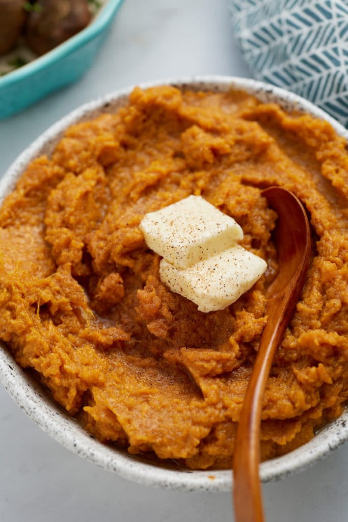 sweet potatoes with butter on top and spoon sticking out