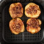 The baked apples in the air fryer basket.