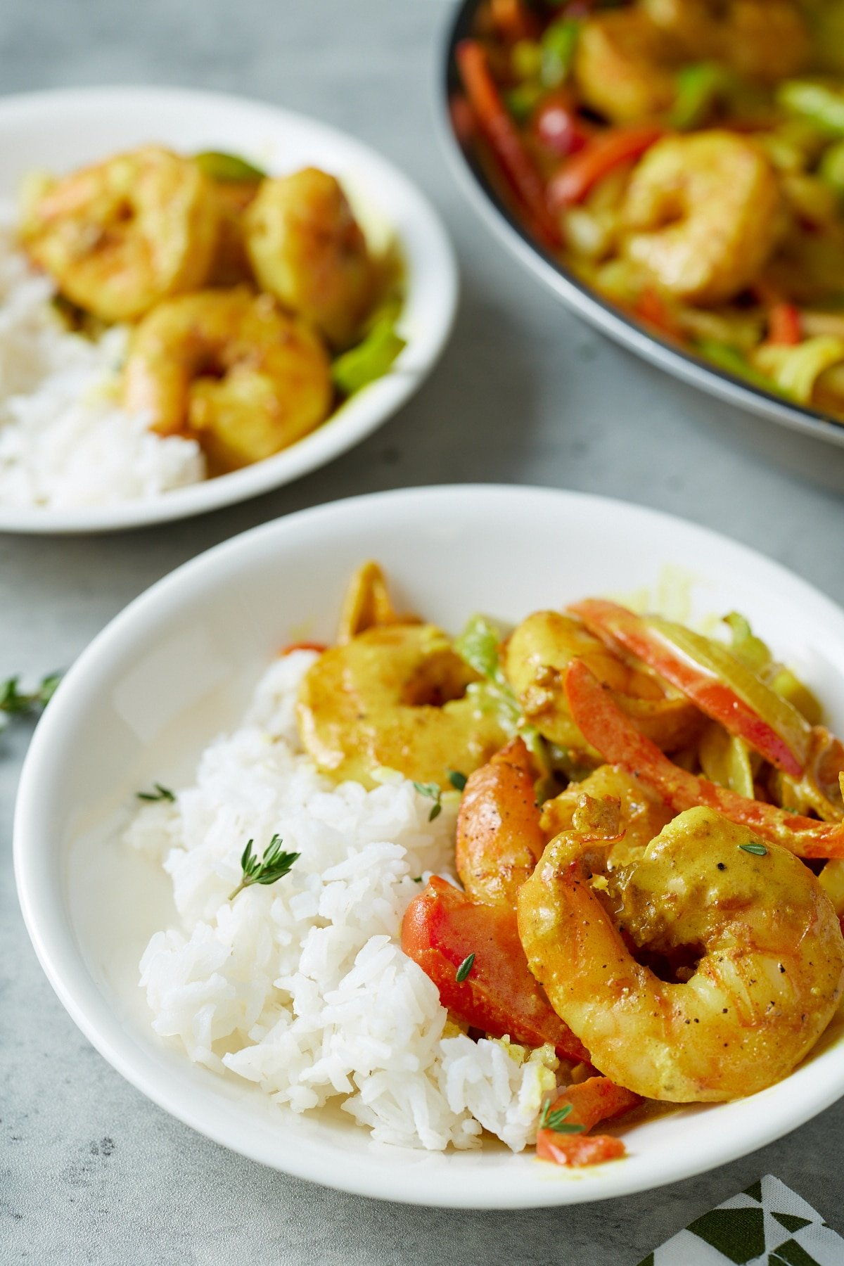 jamaican curry shrimp with rice on white plate