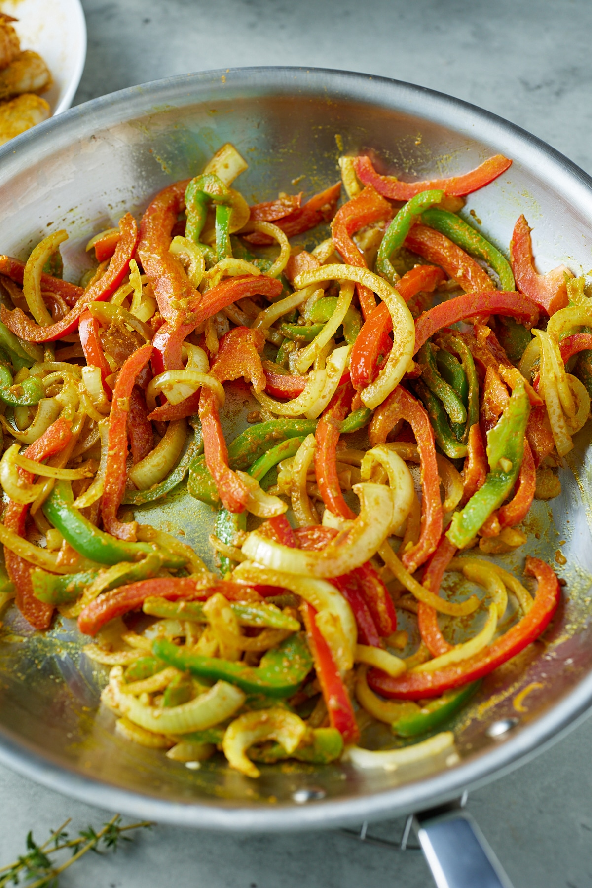 cooked peppers and onions with curry powder added
