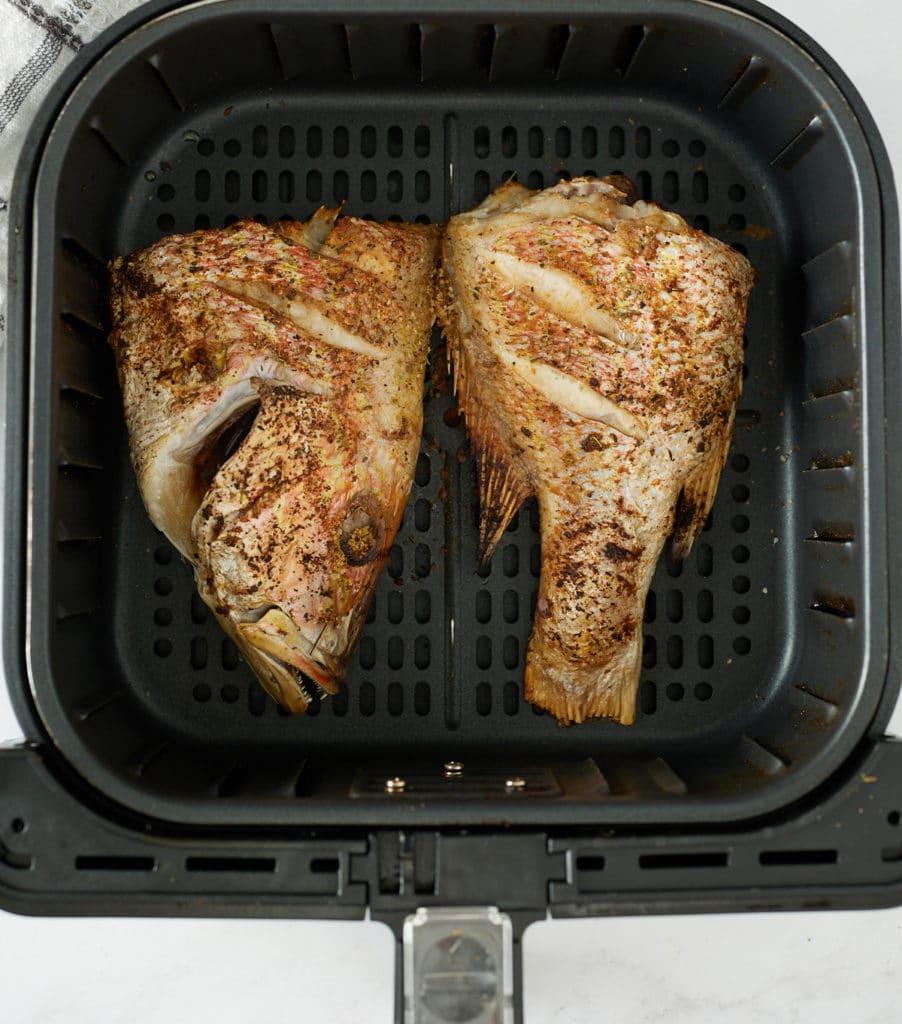 cooked fish filet in air fryer basket
