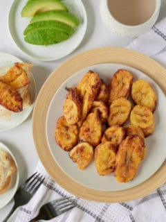 Air fryer plantains served on a white plate.