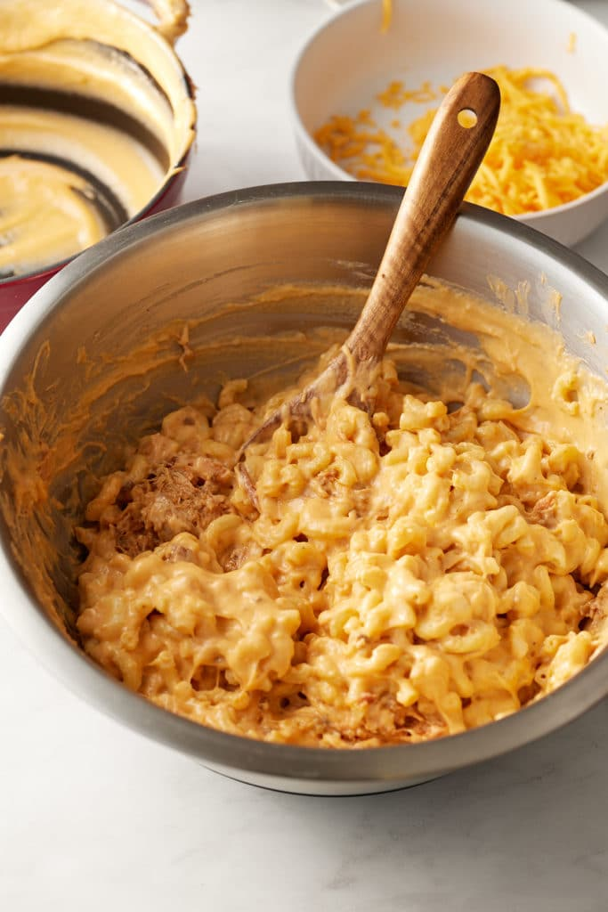 The cheese sauce stirred into the macaroni.